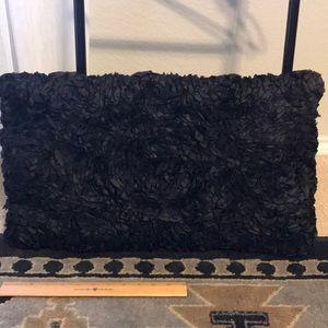 Black satin rosette textured pillow 22 in x 13 in
